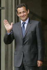 France's President Nicolas Sarkozy waves as Jordan's King Abdullah leaves the Elysee Palace in Paris