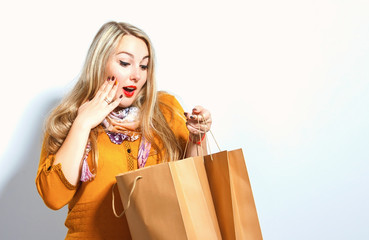 Beautiful blonde girl with shopping bags