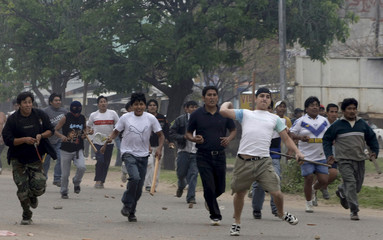 Supporters of President Evo Morales throw stones during strike in Santa Cruz