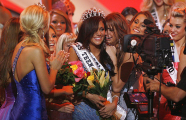 Hilary Carol Cruz from Louisville, Colorado, is congratulated after being crowned Miss Teen USA 2007 at the Pasadena Civic Auditorium in Pasadena