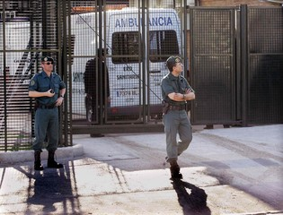 Spanish policemen stand guard outside a courthouse at the start of al Qaeda trial in Madrid.