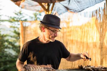 Street chef roasting meat