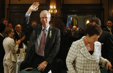 Liberal leader Dion waves at the crowd prior to his speech before the members of the Chamber of Commerce in Quebec City