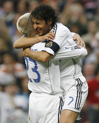 Real Madrid's Raul celebrates his goal against Deportivo Coruna with team mate Beckham during their Spanish First Division soccer match in Madrid
