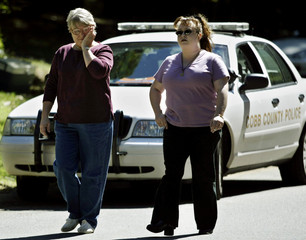 Neighbors leave home of Jack Hensley as they awaited word of his fate from the State Department.
