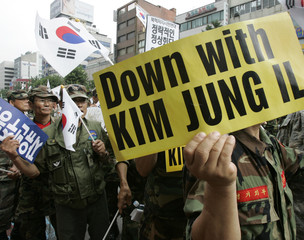 Anti-North Korea protesters including veterans chant slogans at a pro-U.S. rally opposing the planned inter-Korean summit as they commemorate Korea's liberation day from Japan's 1910-45 colonial rule, in Seoul