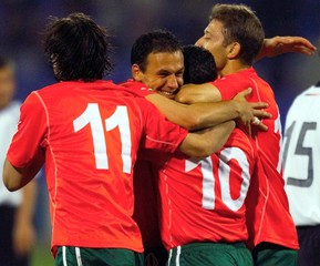 MEMBERS OF BULGARIAN TEAM CONGRATULATE BALAKOV AFTER GOAL AGAINSTGERMANY IN SOCCER FRIENDLY.