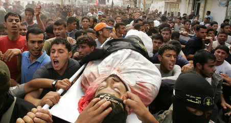 Palestinians carry the body of Islamic Jihad militant al-Basyoni in the northern Gaza strip