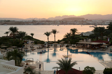 FILE PHOTO: A general view of Naama bay and a swimming pool of a hotel during sunset in the Red Sea resort of Sharm el-Sheikh