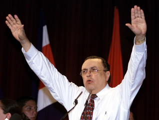 Costa Rican presidential candidate Abel Pacheco waves to his supporters after the first election res..
