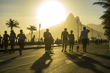 Bright scenic view of the Ipanema Beach boardwalk on a golden sunset afternoon in Rio de Janeiro, Brazil