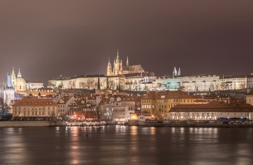 Night and Vltave river, Castle of Prague, St. Vitus Cathedral, Palace and Church. Long Exposure. Prague, Czech.