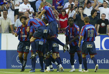 Levante's players celebrate after scoring against Valencia during their Spanish First Division soccer match at the Ciudad de Valencia Stadium in Valencia