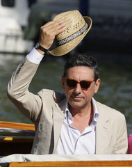 Italian actor Castellitto poses as he arrives in a water taxi at the 66th Venice Film Festival