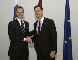 Latvia's Minister of Foreign Affairs Riekstins and his Finnish counterpart Stubb pose for media during their meeting in Riga