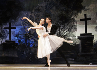 """Ballet dancers Berezina and Kuroshu perform as Giselle and Albrecht during their dress rehearsal of """"Giselle"""" in Madrid"""