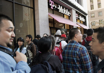 Customers wait in line to purchase the Google T-Mobile G1 telephone at a T-Mobile store in San Francisco