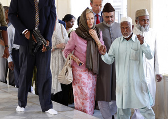 Belgium's Queen Paola is welcomed by officials at Macca Masjid in Hyderabad