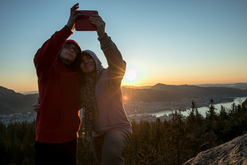 Woman taking a picture using Smartphone