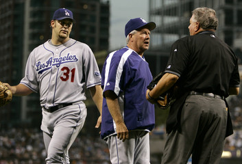 Los Angeles Dodgers manager Little gets between his starting pitcher Penny and home plate umpire Reed in San Diego
