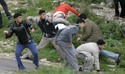 Palestinian youths throw stones at Israeli troops in Nablus