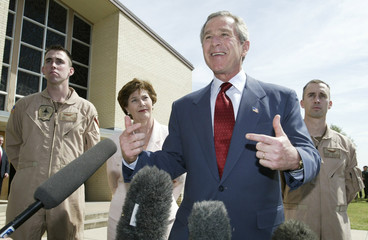US PRESIDENT GEORGE W BUSH SMILES AS HE TALKS NEXT TO FORMER POWWILLIAMS AND YOUNG AFTER EASTER CHURCH ...