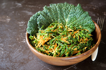 Cole Slaw salad with carrots and savoy cabbage. Close-up view. Concept of healthy living