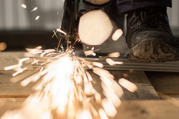 Work with the sander, the sparks flying into the lens