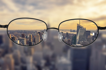 Clear cityscape focused in glasses lenses