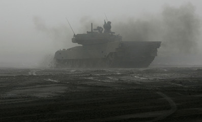 Japan's Ground Self-Defense Force's Type 90 tanks participate in a Comprehensive Fire Power Exercise at Higashifuji training field in Gotemba
