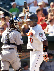 Orioles' Tejada reacts after striking out against Blue Jays' Chacin at Camden Yards in Baltimore, Maryland.