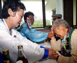 SOUTH KOREAN KIM MEETS HER NORTH KOREAN DAUGHTERS AT NORTH KOREA'S MT. KUMGANG RESORT.