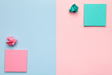 Sticky Notes with Crumbled Paper Balls on Pastel Background