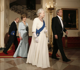 Queen Elizabeth II walks with U.S. President Bush and first lady Bush at the White House in Washington