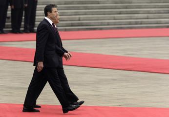 Chinese Premier Wen walks with Denmark's PM Rasmussen in Beijing