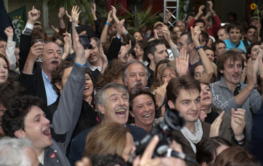 Leaders and members of the green Europe Ecologie party react during the announcement of the estimated results of the European parliament election in Paris