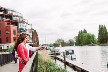Couple looking into the river from a bridge