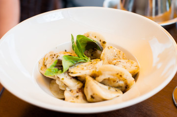 Tortelllini food on the table.