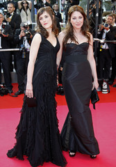 Cast members Poidatz and Smet pose on the red carpet at the 61st Cannes Film Festival