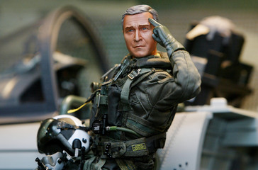 MINIATURE REPLICA OF GEORGE W. BUSH IN NAVAL FLIGHT UNIFORM IN HONGKONG.