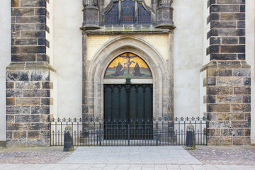 church door  / Door with theses  of the castle church in the Luther city Wittenberg