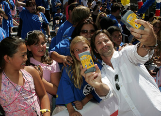 "Actor Breckin Meyer takes a self portrait with some fans as he arrives at the World Premiere of ""Herbie ..."