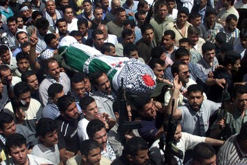 PALESTINIANS CARRY THE BODY OF AZZAM MIZHER DURING HIS FUNERAL IN BALATA CAMP NEAR NABLUS.