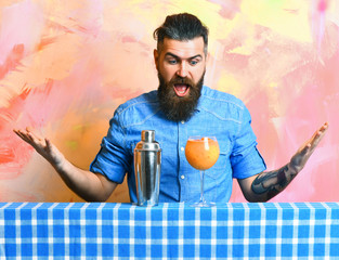 Brutal caucasian hipster with tropical alcohol fresh cocktail