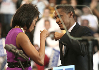 U.S. Democratic presidential candidate Senator Obama bumps fists with his wife Michelle before his speech in St. Paul