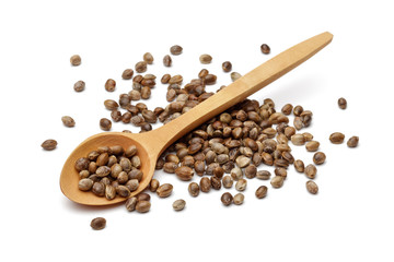 Hemp seeds with wooden spoon