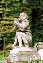 Statue of a praying angel on the cemetery