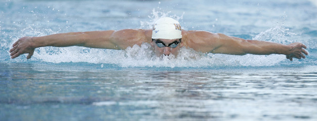Michael Phelps swims to a win in men's 200 meter butterfly event in Santa Clara