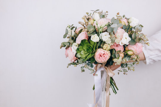 Beautiful bouquet in the hands of a florist