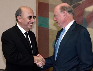 US Treasury Secretary Snow shake hands with Brazil's Central Bank President Meirelles in Brasilia.